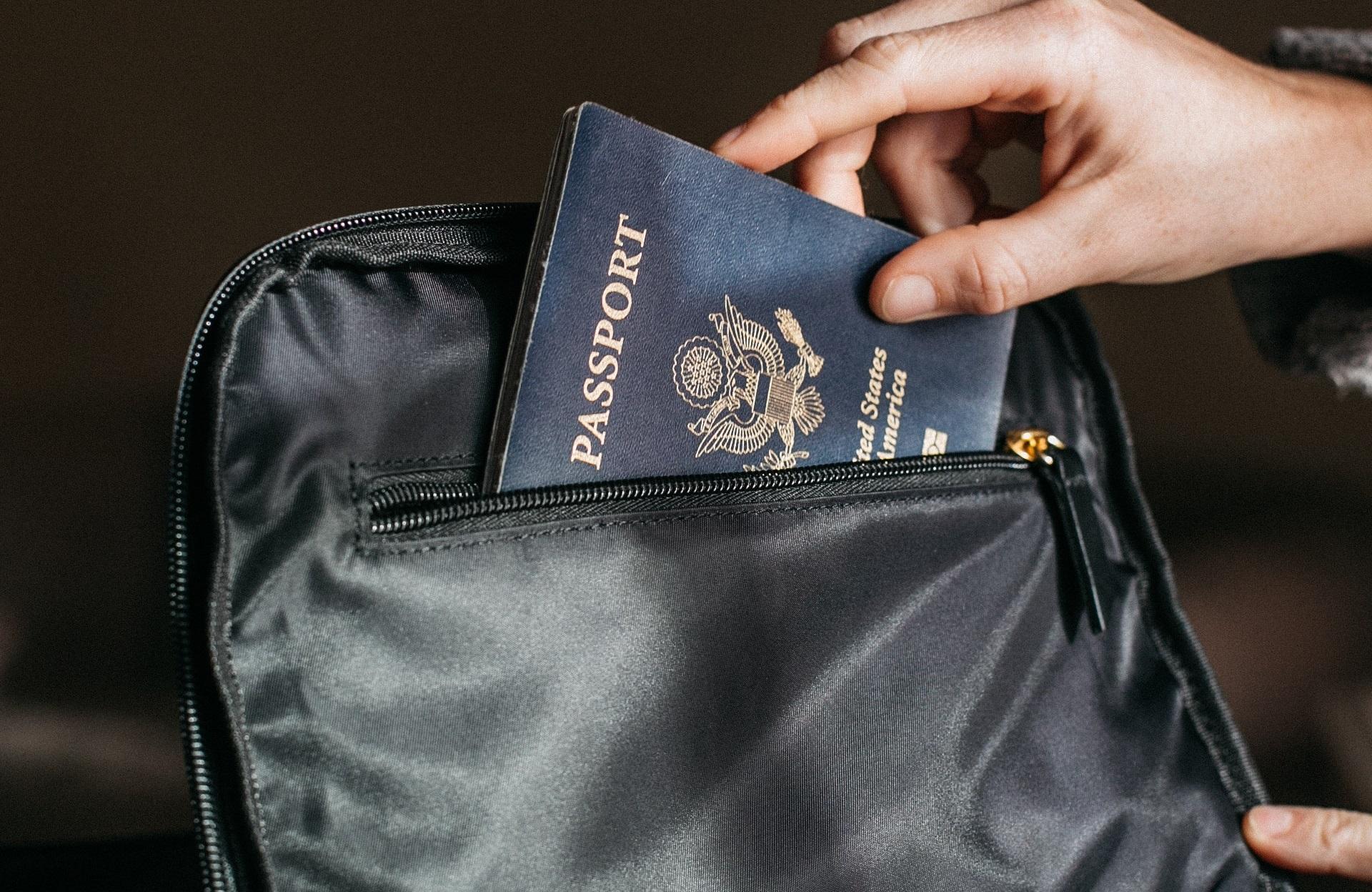 Photo_placing passport in bag